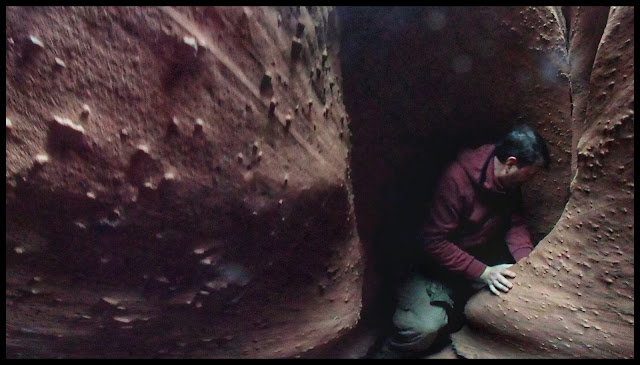 Traversing Turns and Drops in the Narrow Spaces of Spooky Gulch Slot Canyon - Escalante Utah