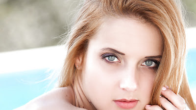 Hot blonde centerfold Roberta Berti posing for softcore photos outdoors