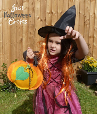 Girl dressed in costume as a Witch with a small pumpkin shaped bag