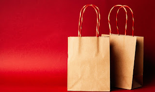 Two tote bags in a red background