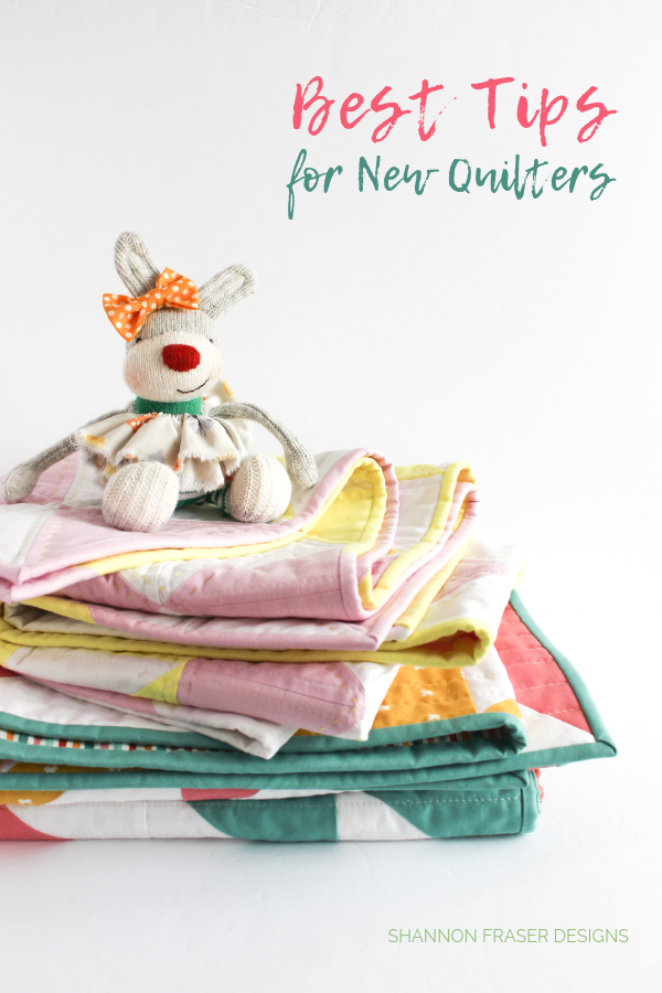 Louise the Bunny on a stack of Pink Lemonade quilts | Best of 2019 | Shannon Fraser Designs #sockbunny #quilts #stackofquilts