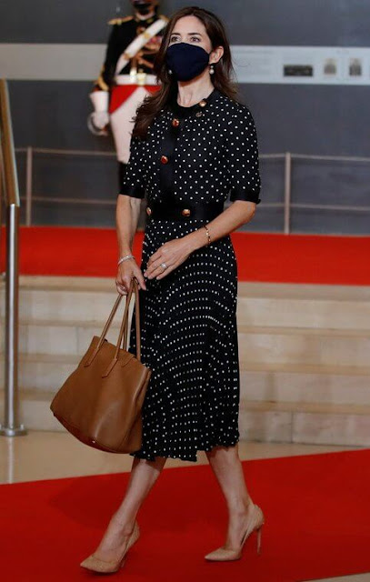 Crown Princess Mary wore a new polka dot pleated dress from Prada. French President Emmanuel Macron