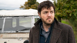 Tom Burke and a white land rover
