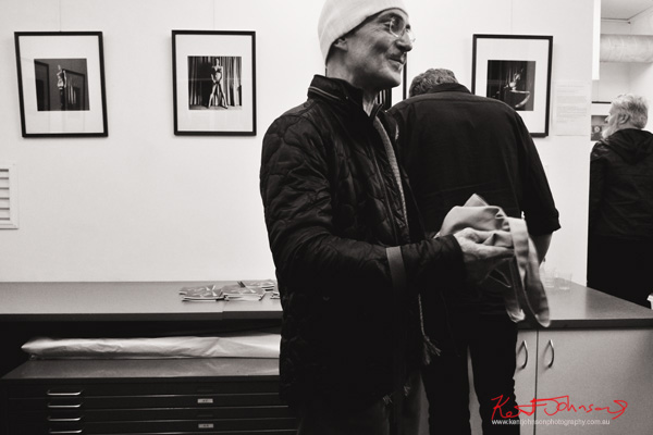 "Photographer Emmanuel Angelicas and artworks at Blanco Negro for the opening of ""Caprice - Je ne Sais Quoi""  Photographed for Street Fashion Sydney by Kent Johnson."