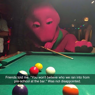 cosplay barney dinosaur in pub