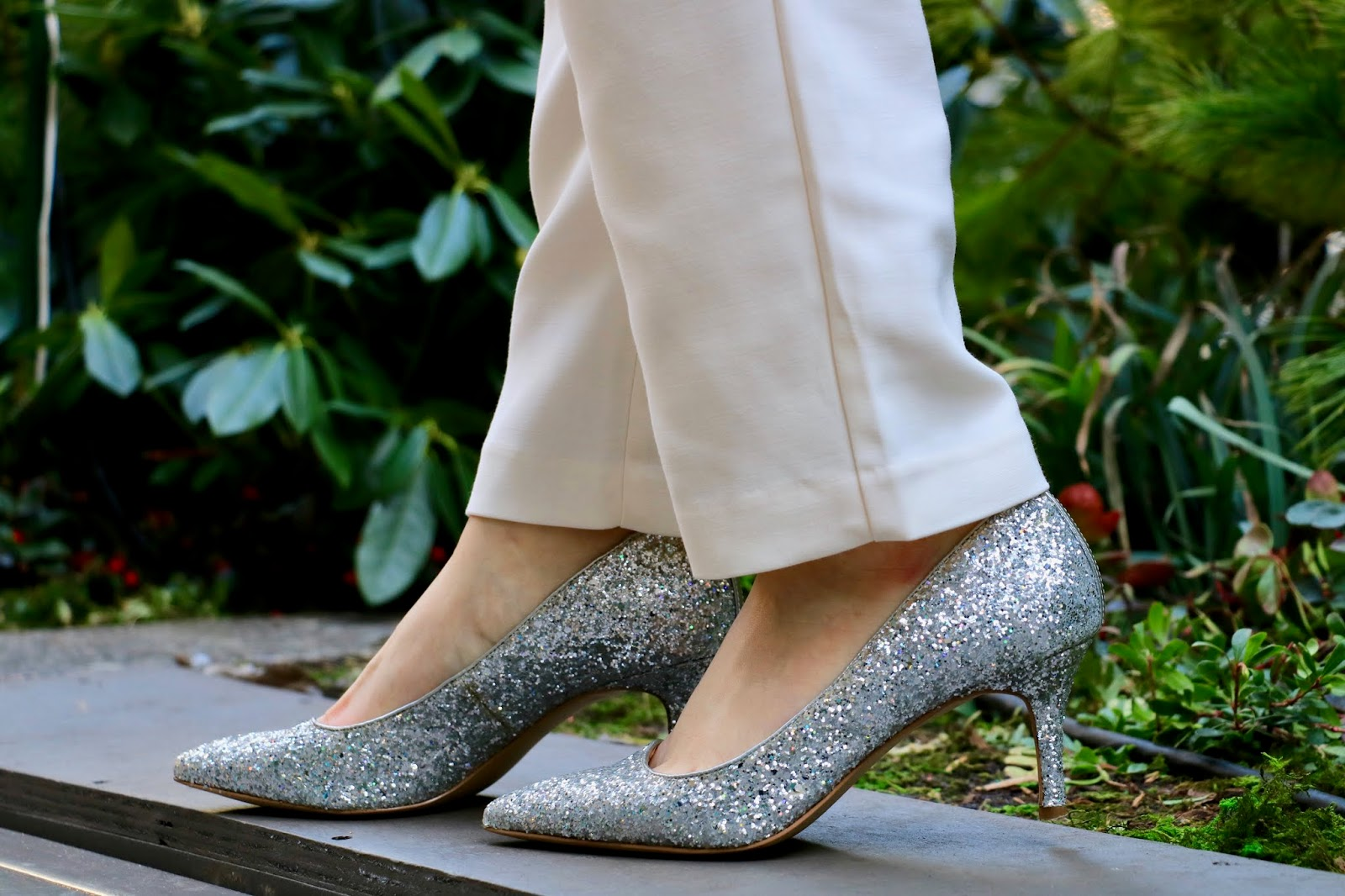 Nyc fashion blogger Kathleen Harper wearing silver glitter heels from Ann Taylor.