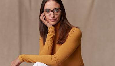 K'Mich Wedding - wedding planning - eye wear - chic opulence - lady in a mustard turtleneck - round frame eye wear