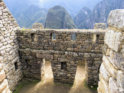 Machu Picchu Photos: Two trapezoidal doors at Machu Picchu with views of the Andes beyond.