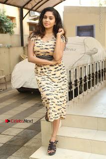Telugu Actress Karunya Chowdary Stills in Short Dress at ATM Not Working Press Meet  0278.jpg