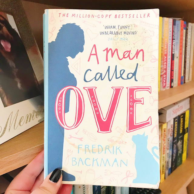 A man called ove by fredrick backman held up in front of bookshelf