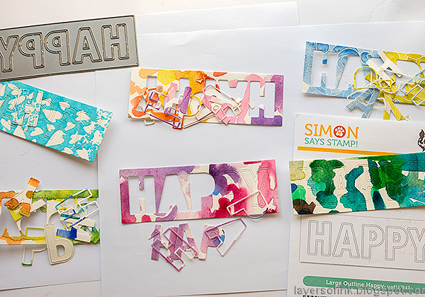 Layers of ink - Happy Art Journal Page Video Tutorial by Anna-Karin Evaldsson. Die cut the Simon Says Stamp Large Outline Happy die.