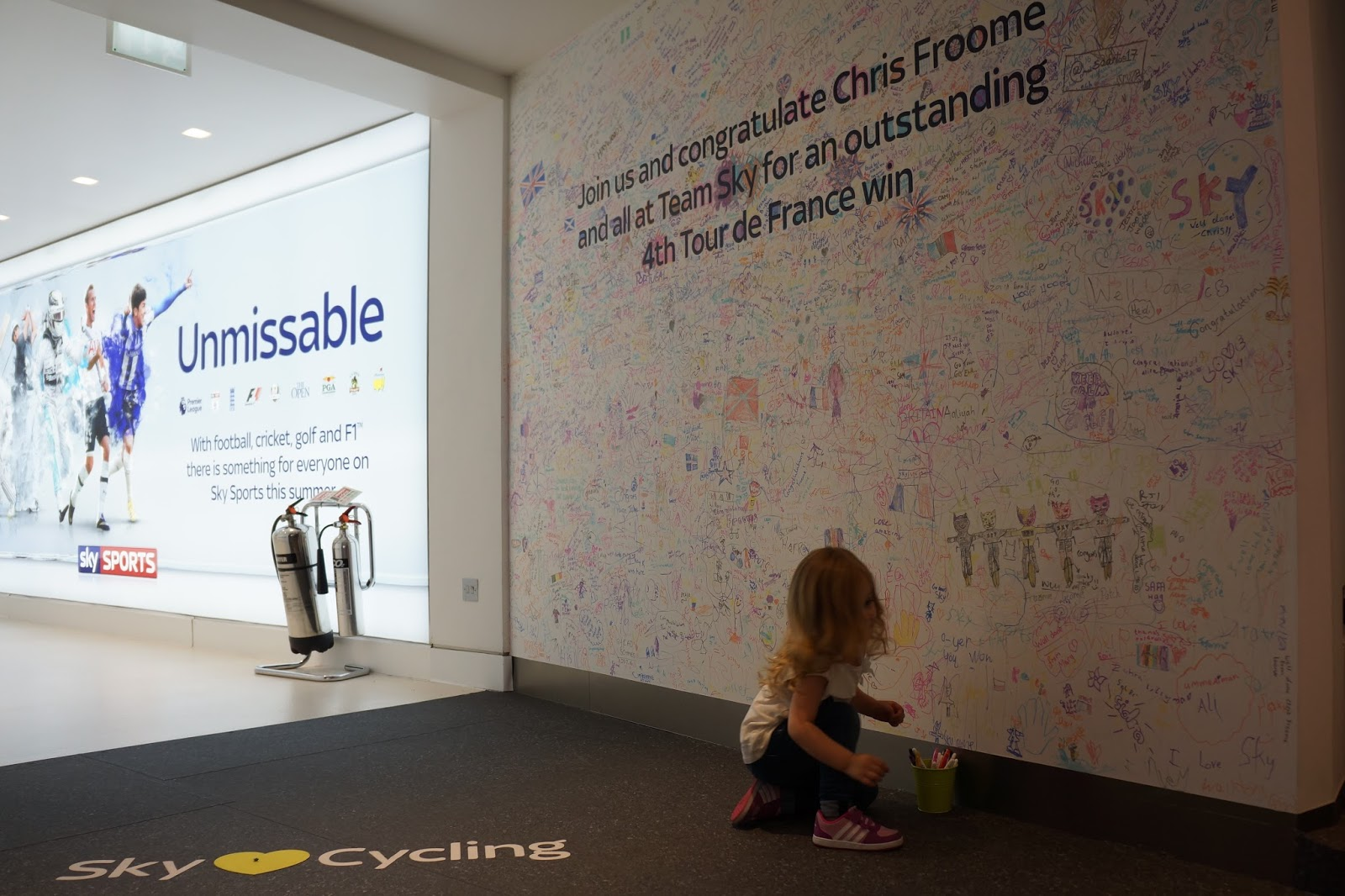 a wall with congratulations and drawings for chris foome for winning tour de france