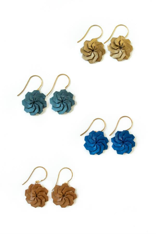 four pairs of circular origami earrings folded from blue and gold papers