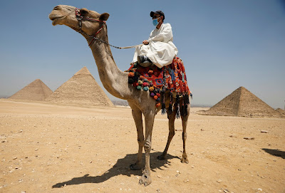 """At the pyramids plateau of Giza after re-opening  """"Reuters"""""""