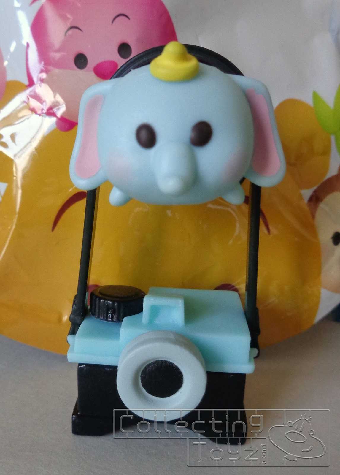 4835853e8 We opened our pack up and pulled Dumbo! It comes in 2 pieces, Dumbo and the  Camera which are bagged separately so you do have to do some minor assembly  but ...