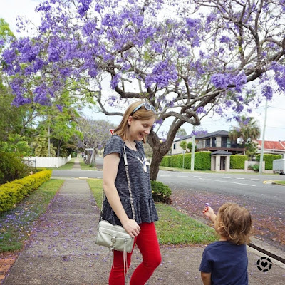 awayfromtheblue Instagram | peplum tee with red skinny jeans fashion blogger mum life outtake with spring playground outfit jacaranda