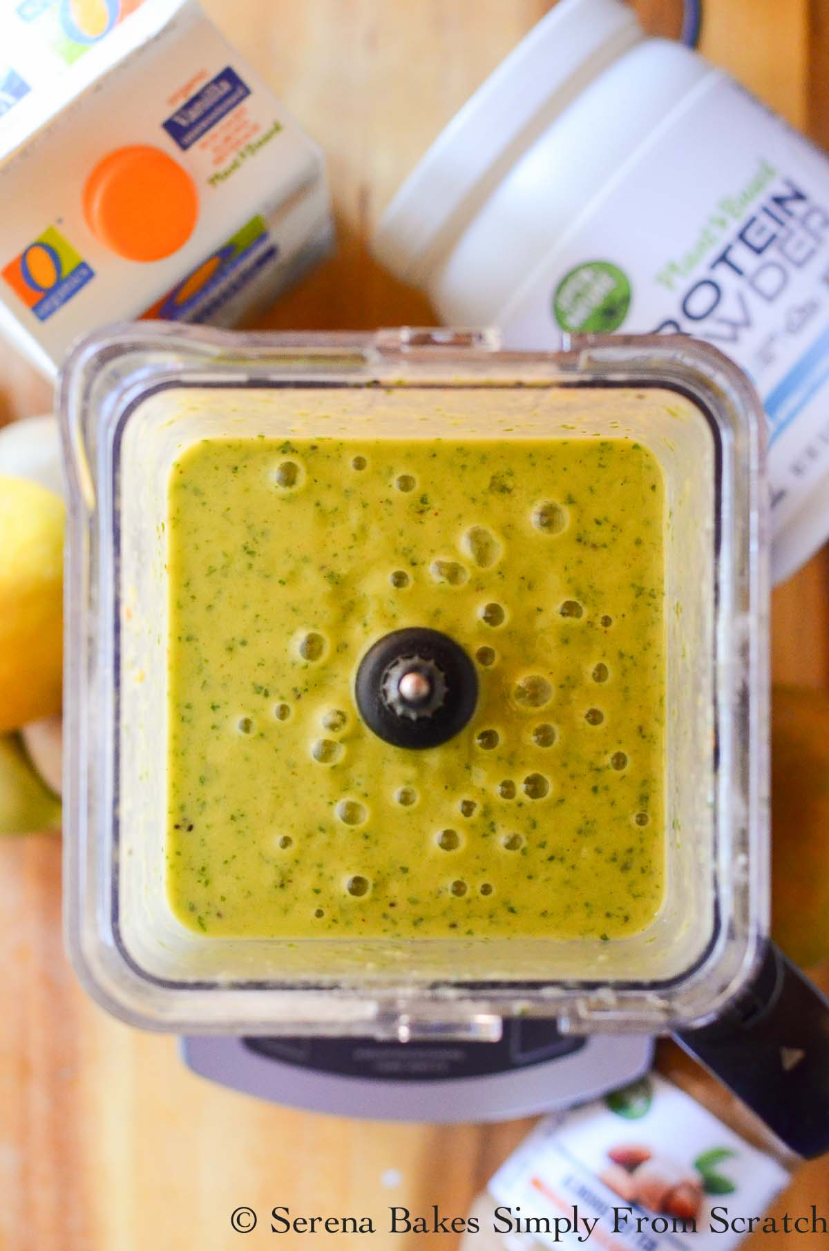 Tropical Green Smoothie down shot in a blender.