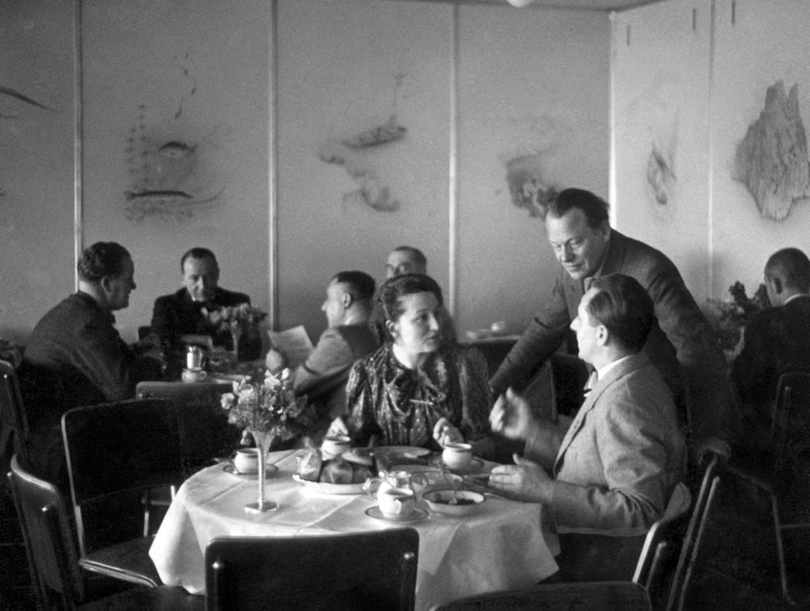 Passengers in the dining room of the Hindenburg, in April of 1936.
