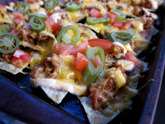 Game Day BBQ Pork Nachos Recipe - BBQ Pork, Cheese, Sour Cream, Tomatoes, Jalapeños and Tortilla Chips - Quick Recipe for a party! These are always gone in a flash!
