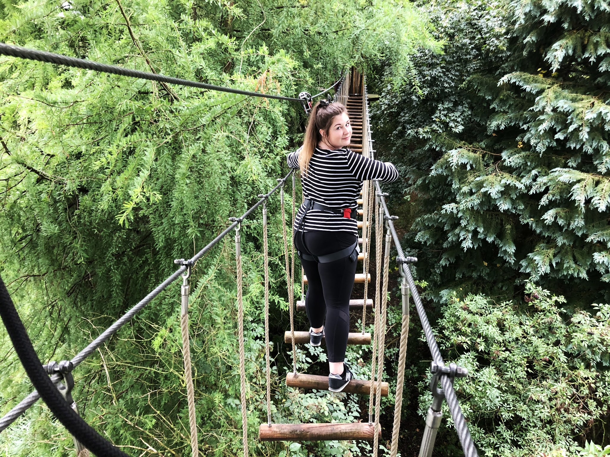 Grace standing on one of the many wooden crossings