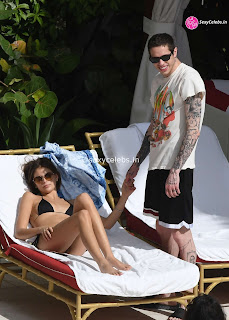 Kaia Gerber in tiny wet black bikini tongue kissing Pete Davidson in Miami Beach Pool Celebs.in Exclusive 017