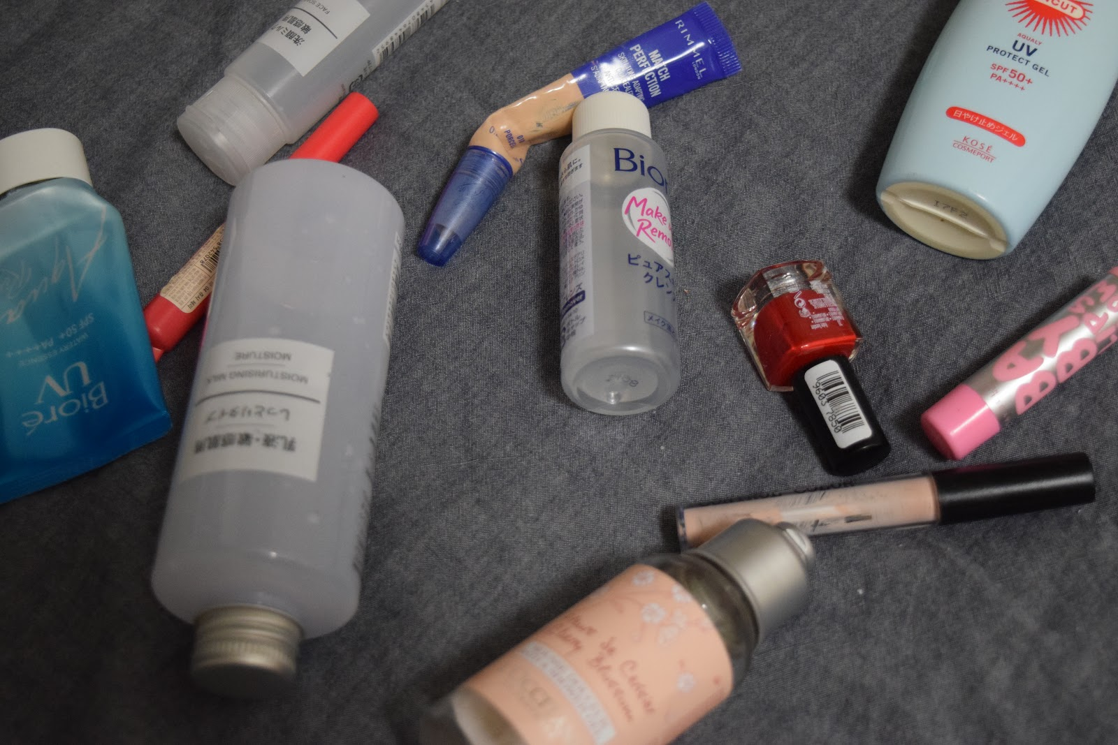 flatlay of empty beauty products from Japan and the UK