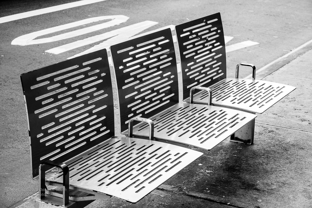 a photo of a bench in new york city in black and white photography daniel south