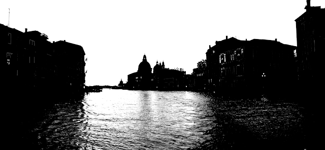 Venice silhouette with domes and churches and the river