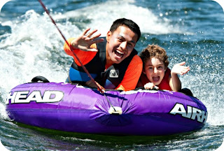 Camper and counselor tubing at summer camp.