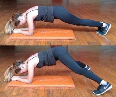 Abrir y cerras las piernas con apoyo sobre antebrazos para ejercitar los abdominales y piernas
