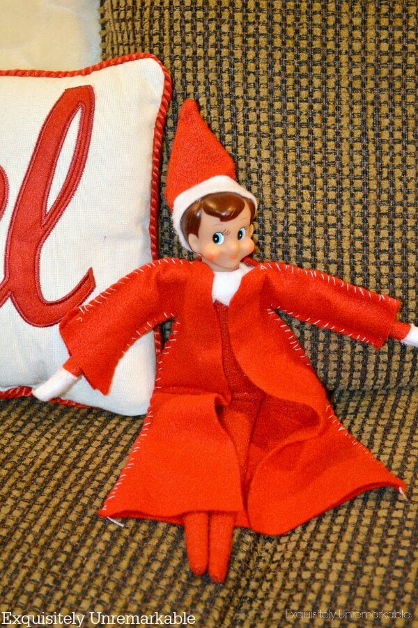 Elf On The Shelf With Clothes Sitting In a Chair