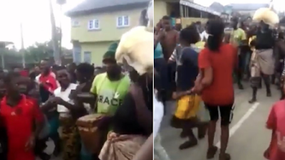 [Video] Nursing Mother, Publicly Disgraced For Stealing Garri in Delta