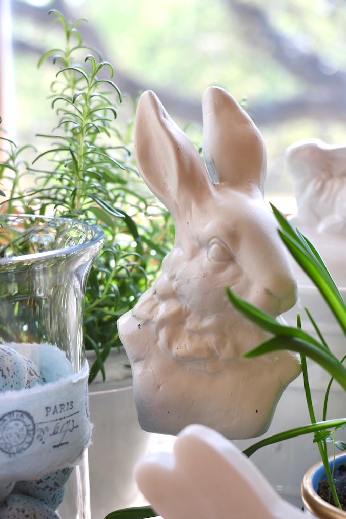 A French hare keeps watch over a Spring Blue and White Basket Arrangement