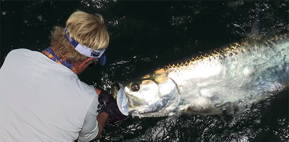 Capt Blair Wiggins with a Tarpon