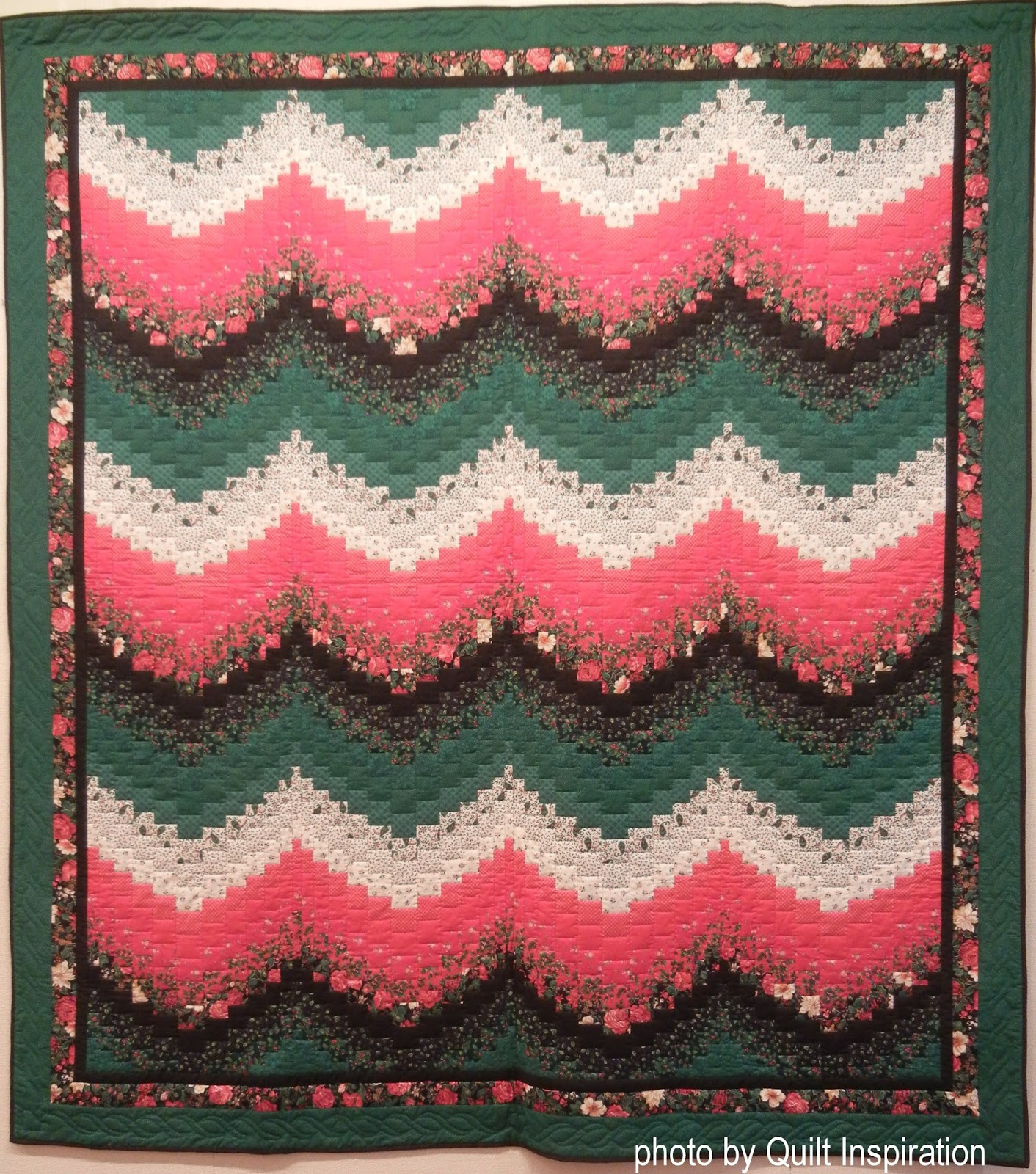 58878aed3a Geneal's elegant bargello quilt is done in restful shades of muted green,  red, ivory, and deep black solid fabrics. The rose print fabric of the  border and ...