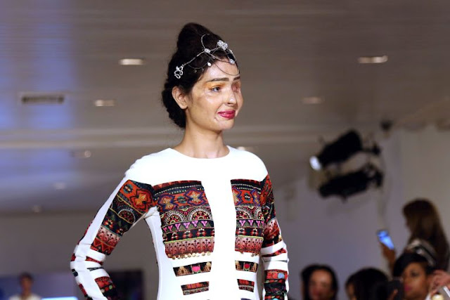 Indian acid attack survivor Reshma Qureshi walks the New York runway