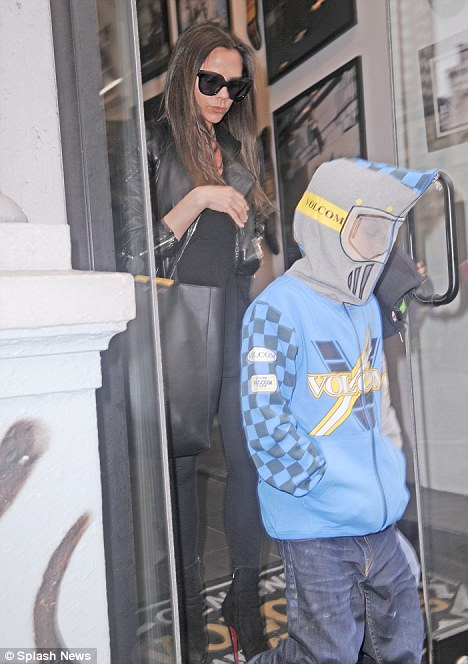 Who goes there? Victoria Beckham's sons disguise themselves with face-covering hoodies