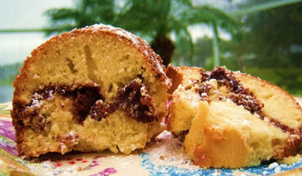 old fashioned vintage cinnamon sour cream coffee cake with a delicious nut filling