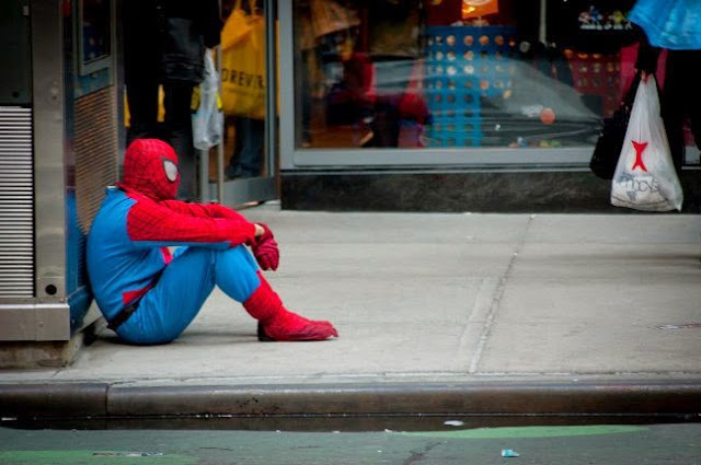 This picture would be even more awesome if sad Spidey were doing this in the shower, with his suit and mask still both on, and 'Everybody Hurts' was playing.