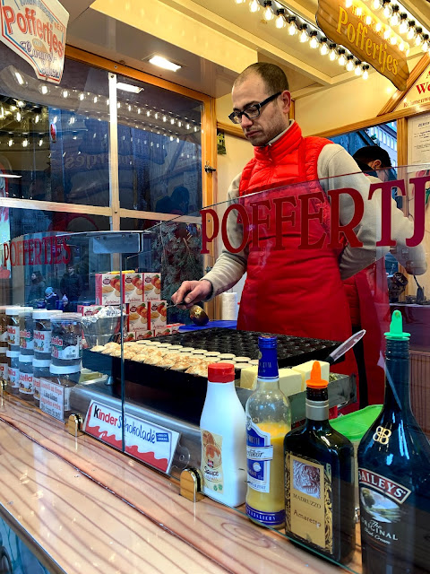 man cooking poffertjes at Bremen Christmas market