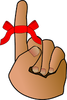 finger with ribbon tied around it