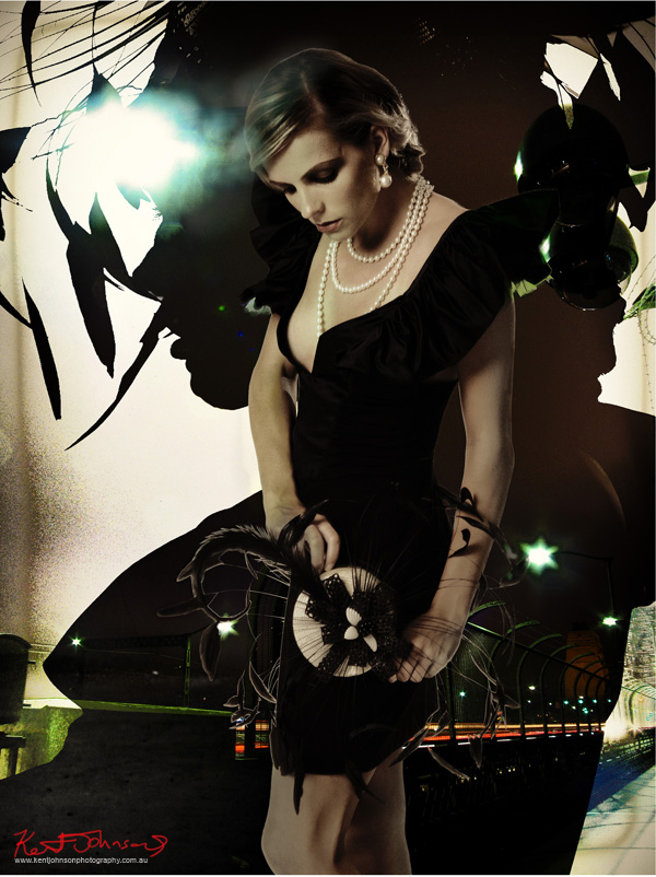 Black dress and feather hat - A Constructivist style fashion photoshoot incorporating the Sydney Harbour Bridge at night, concept and photography by Kent Johnson