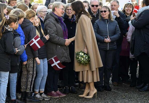 Crown Princess Mary wore Oscar De La Renta camel hair wool-blend cape, CO wool sweater, Naledi Copenhagen clutch
