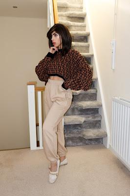 The Femme Luxe Brown Black Long Sleeve Crop Jumper in model Sienna