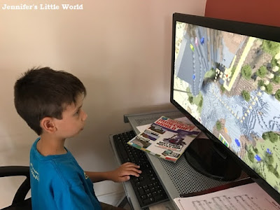 Child playing Minecraft on the computer