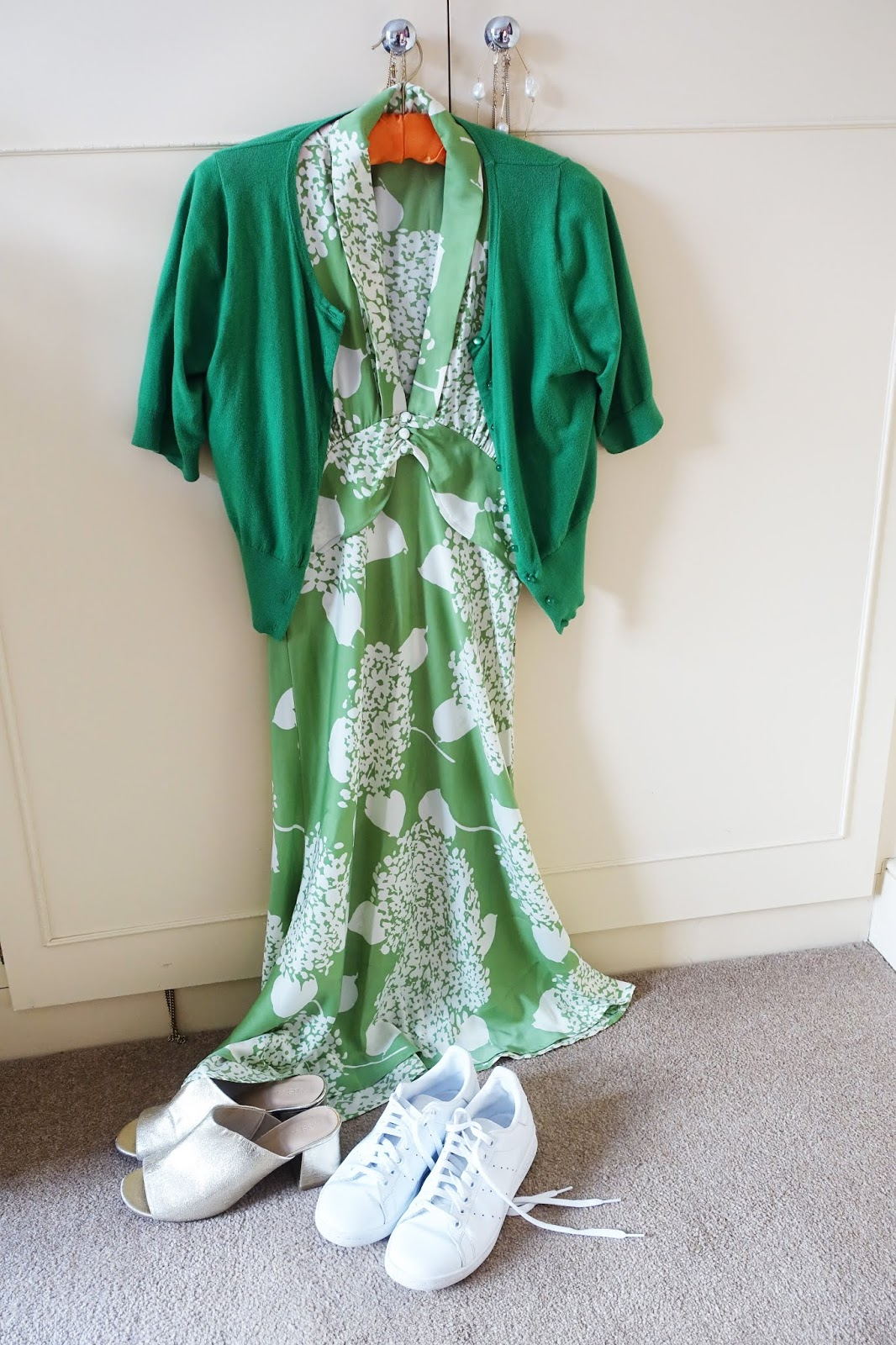Hydrangea print dress from Nancy Mac styled with either mules or white trainers and a green cardigan by over-50s blog Is This Mutton?