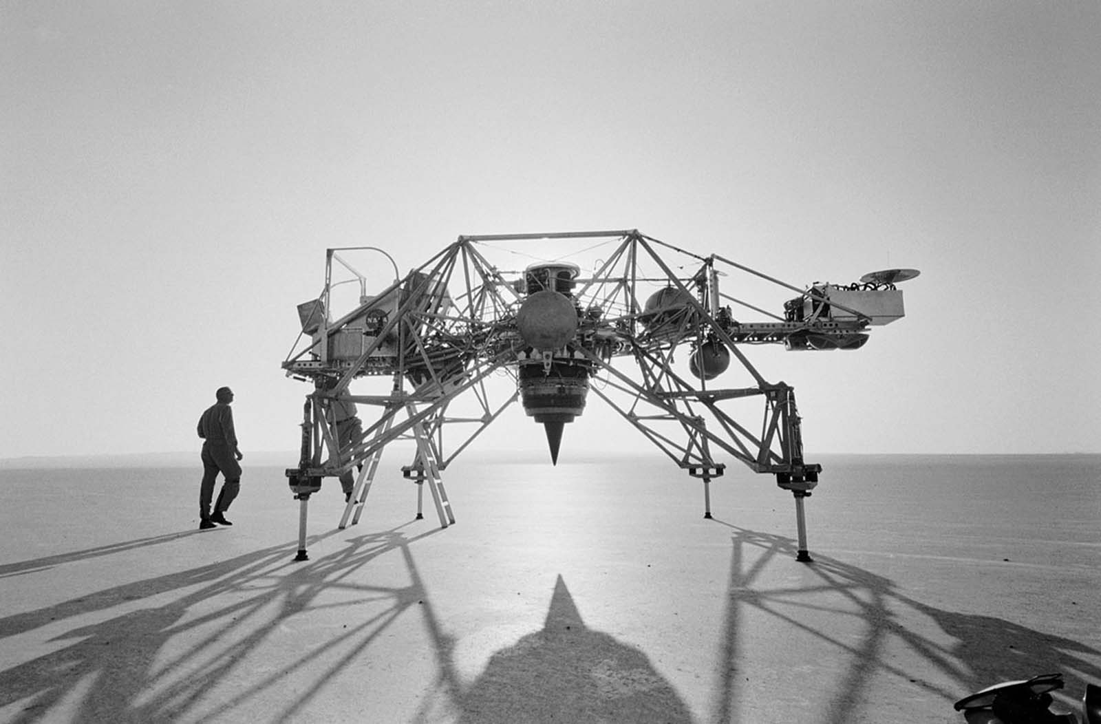 The Bell Aerosystems Lunar Landing Research Vehicle (LLRV) and the astronaut Neil Armstrong (left), photographed at Edwards Air Force Base in Southern California prior to the launch of Apollo 11.