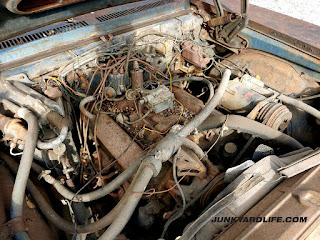 1970 Chevy Nova 307-V8 engine under hood photo show decades of dirt and neglect.