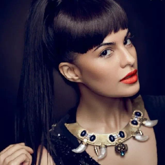 High Ponytail With Bangs