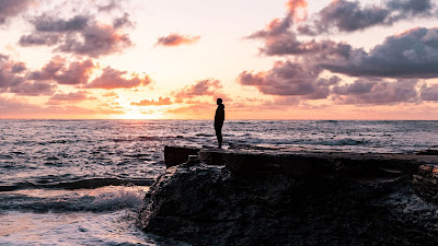 Lonely man, silhouette, rock, sea, sunset